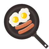 Eggs and sausage in pan Stock Photo