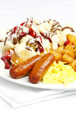 Eggs sausage potatos and waffle with fruit Royalty Free Stock Photography