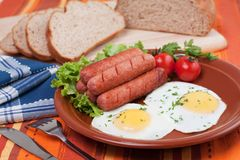 Eggs and sausages Stock Photos