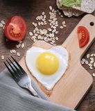 Eggs in the shape of a heart Stock Images