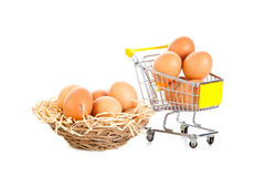 Eggs and shopping trolly isolatedon white background food Stock Photo