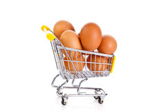 Eggs and shopping trolly isolatedon white background Royalty Free Stock Photo