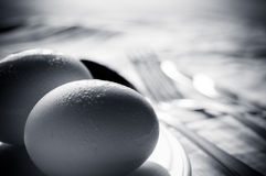 Eggs with silverware Stock Images