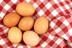 Eggs. Six brown eggs on a tablecloth royalty free stock photos