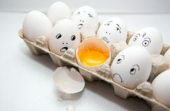 Eggs with smile Stock Images