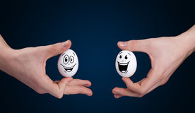 Eggs with smiley faces Stock Image