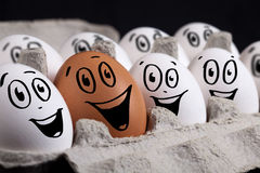 Eggs with smiley faces in eggshell Royalty Free Stock Photography