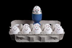 Eggs with smiley faces in eggshell with a boss Stock Photography