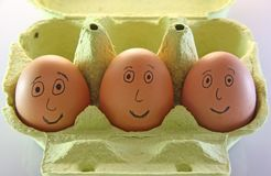 eggs with smiling eyes nose and mouth Stock Images