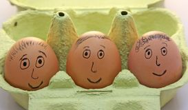 Eggs with smiling eyes and nose and mouth and hair Stock Images
