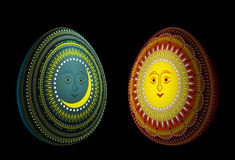 Eggs with solar and lunar ornaments Stock Images