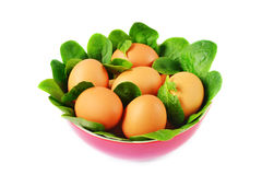 Eggs and spinach in the bowl Stock Photography