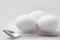 Eggs and a spoon. Royalty Free Stock Images