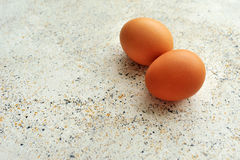 Eggs on spotted textured background Stock Images