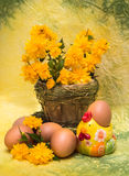 Eggs and spring flowers with a figure of a chick Royalty Free Stock Photos