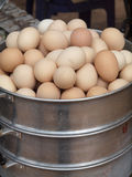 Eggs in steam pot Royalty Free Stock Image