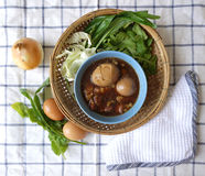 Eggs stewed on woven basket Royalty Free Stock Images