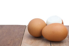 Eggs. Still Life-Eggs laid on the old wooden floor and white background peeled eggs laid back Royalty Free Stock Image