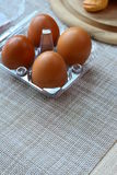 Eggs storage box on gray placemat Royalty Free Stock Images