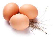 Eggs with a straw Stock Image