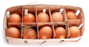 Eggs with a straw Royalty Free Stock Image