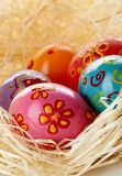 Eggs in straw Royalty Free Stock Images