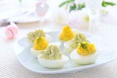 Eggs stuffed with cheese and avocado mousse on Easter table Royalty Free Stock Photography