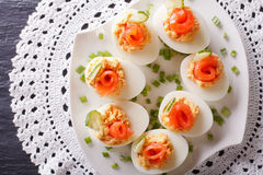 Eggs stuffed with salmon, cheese and cucumber closeup. horizonta Royalty Free Stock Photography