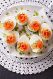 Eggs stuffed with salmon, cheese and cucumber closeup. vertical Stock Photos