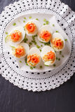 Eggs stuffed with salmon, cheese and cucumber. vertical top view Royalty Free Stock Image