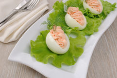 Eggs stuffed with salmon pate. In lettuce leaves Royalty Free Stock Images