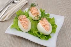 Eggs stuffed with salmon pate. In lettuce leaves Stock Images