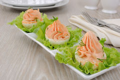 Eggs stuffed with salmon pate. Eggs stuffed with pate salmon with red pepper in lettuce leaves Stock Image