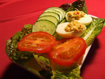 Eggs stuffed and side salad Royalty Free Stock Photo