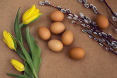 Eggs on the table. Easter eggs with willow branch royalty free stock photography