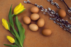 Eggs on the table. Easter eggs with willow branch royalty free stock photos