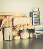 Eggs, Table Ware, Grocery, Different Stuff on Kitchen Table-top. Toned Royalty Free Stock Photography