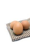 Eggs on tablecloth Royalty Free Stock Photo