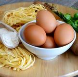 Eggs tagliatelle pasta Stock Photos