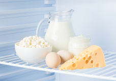 Eggs and tasty dairy products: sour cream, cottage cheese, milk, Royalty Free Stock Photo