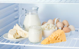 Eggs and tasty dairy products: sour cream, cottage cheese, milk, Stock Image