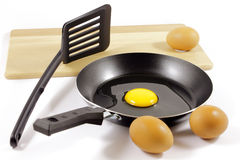 Eggs and teflon skillet Stock Images