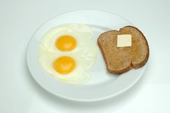 Eggs and Toast. Two sunny side up eggs and toast for breakfast to start off the day Royalty Free Stock Images