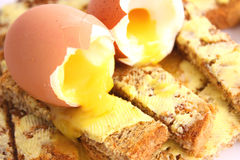 Eggs on toast. Boiled eggs on buttered toast royalty free stock images