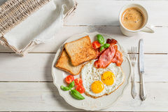 Eggs, toast and bacon for breakfast Royalty Free Stock Image