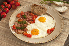 Eggs with toast and bacon for breakfast Royalty Free Stock Image