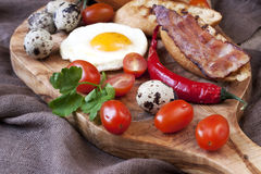 Eggs with toast and bacon for breakfast Stock Images