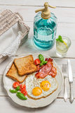 Eggs, toast and bacon for a summer breakfast Stock Photo