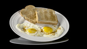 Eggs and toast on a breakfast plate Stock Photos