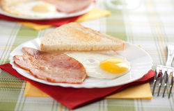 Eggs, toasts and bacon Stock Photo
